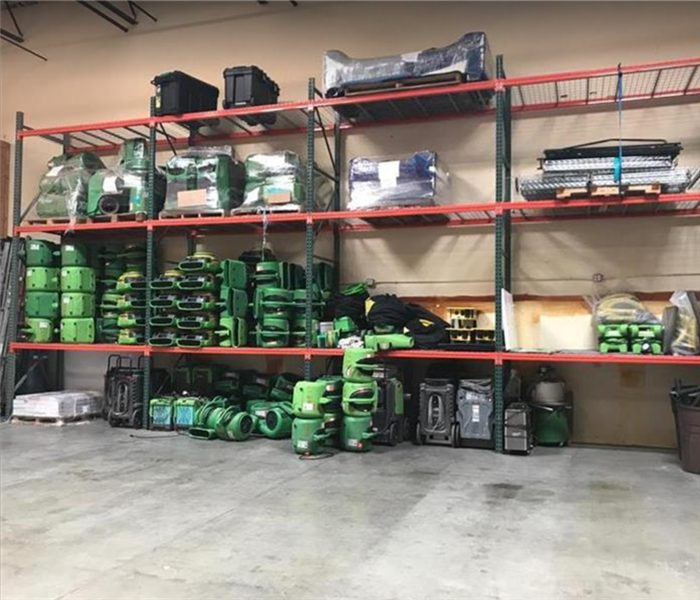 Inside view of SERVPRO facility; Restoration equipment stacked along wall