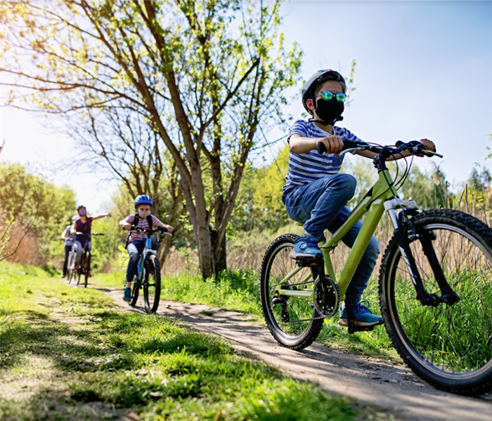 a family riding their bikes on a trail